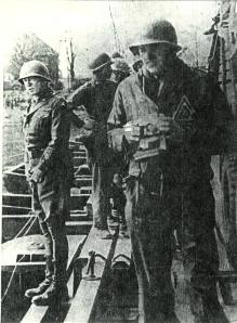 general patton at neirstein, germany, standing on the rhine river bridge relieving himself.
