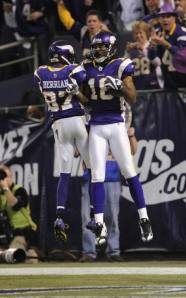 Sidney Rice and Bernard Berrian celebrate a touchdown