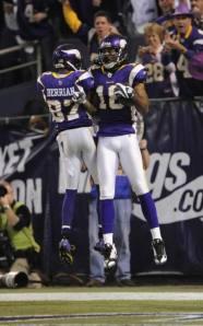 Sidney Rice and Bernard Berrian celebrate a touchdown